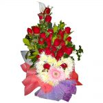 Red roses & a heart shape of flowers in a bouquet