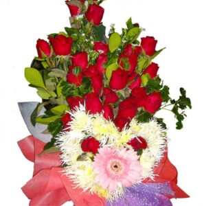 Red roses & a heart shape of flowers in a bouquet, close up