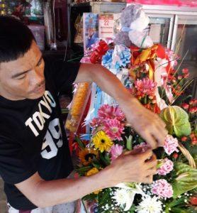 Jack making a flower arrangement