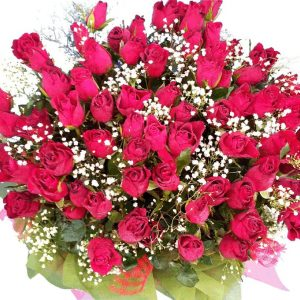 69 red Roses in a bouquet, close up