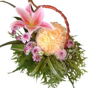 Hand carved melon and Lily in basket of mixed blooms, close up