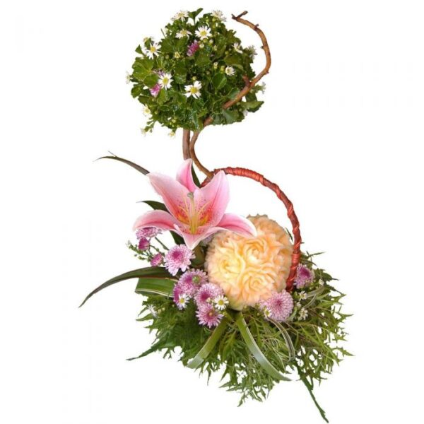 Hand carved melon and Lily in basket of mixed blooms