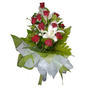 Red Roses and a Lily in a bouquet