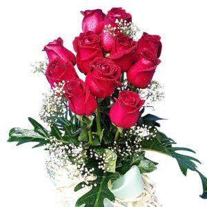 Red Roses in a tall vase, close up