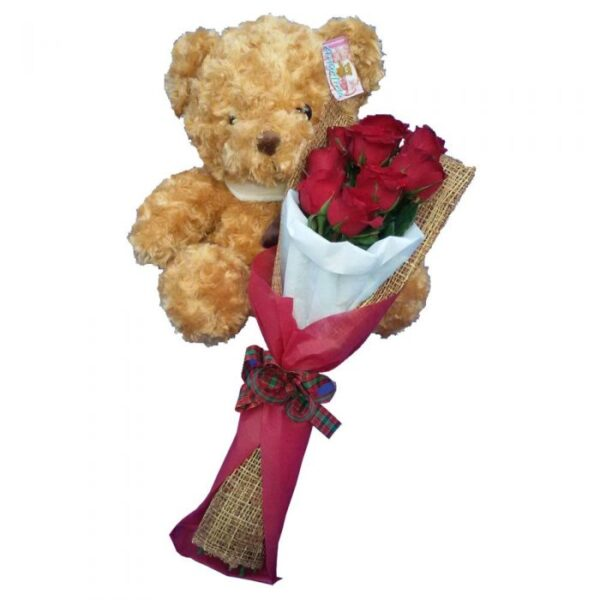 Traditional brown Teddy Bear together with a bunch of Red Rose