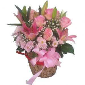 Lilies mixed with Roses & Chrysanthamums in a basket