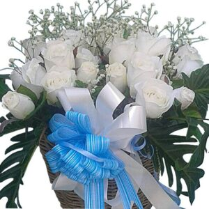 White Roses in a handmade wicker basket - close up