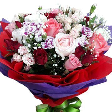 A mix of Roses & Carnations in a bouquet - close up