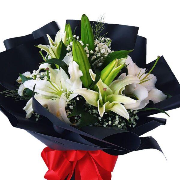 White Lilies Black Wrap Bouquet close up