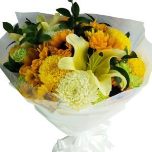 A large bouquet of mixed seasonal blooms of yellow and white
