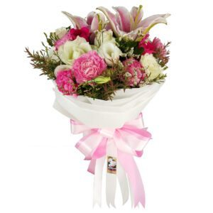 A mixed Bouquet of seasonal blooms in pink and white