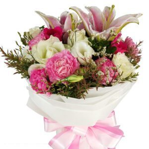 A mixed Bouquet of seasonal blooms in pink and white close up